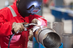 welder working on assembly in the machine shop